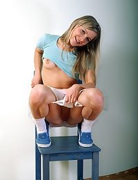 Adolescent on a chair