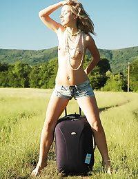 Naked blonde girl having sport posing outdoors