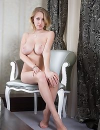 Busty flaxen-haired babe absolutely naked issuance legs on the chair