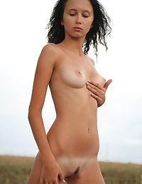 Sweet slim beauty posing of course naked