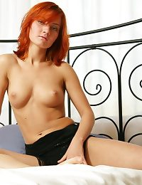 A catch sultry redhead Tamina puts on a dazzling show, flaunting her smooth body and firm assets on the series In flames Top.
