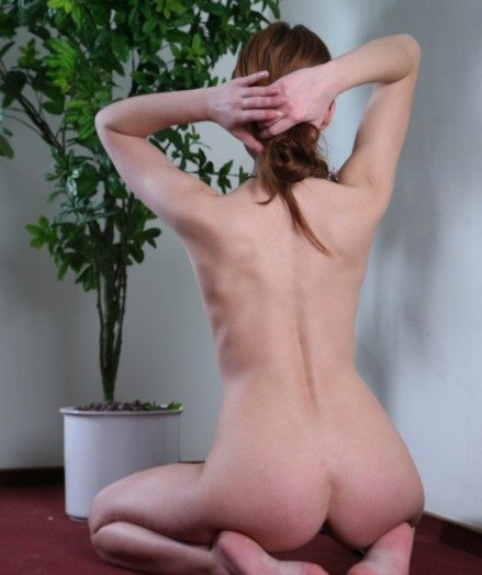 Petite redhead here small breasts takes off her clothes