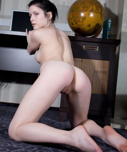 Young brunette youngster spreading her shaved and wet pussy